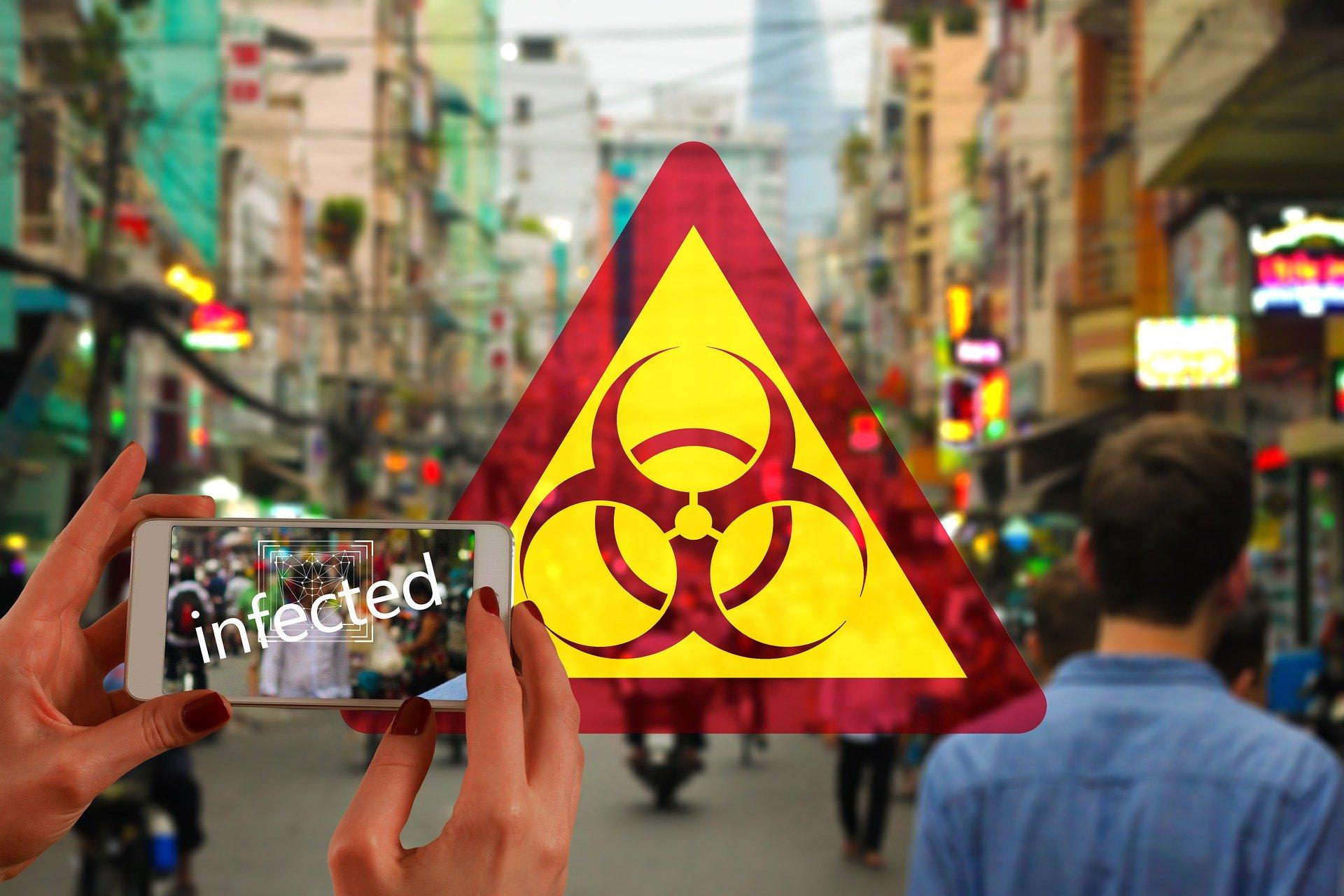 אזהרה מפני נגיף הקורונה בטלפון של אפל. איור: Image by Gerd Altmann from Pixabay